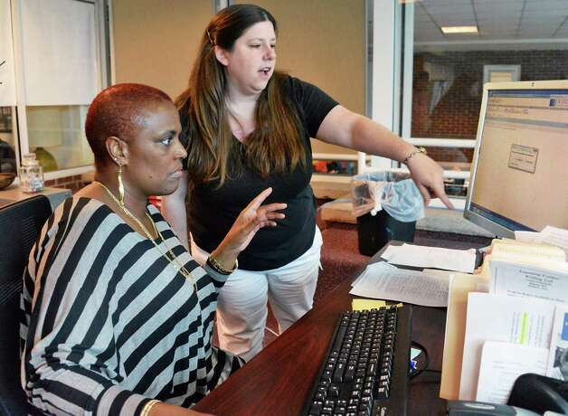 SCCC student Sloane Brown of Schenectady, left, and asst. professor of communication and composition Rae Doyle try out Degree Works, an interactive auditing software that helps students find the clearest path to finishing their degree at the collage Friday May 15, 2015 in Schenectady, NY.  (John Carl D'Annibale / Times Union) Photo: John Carl D'Annibale / 00031869A