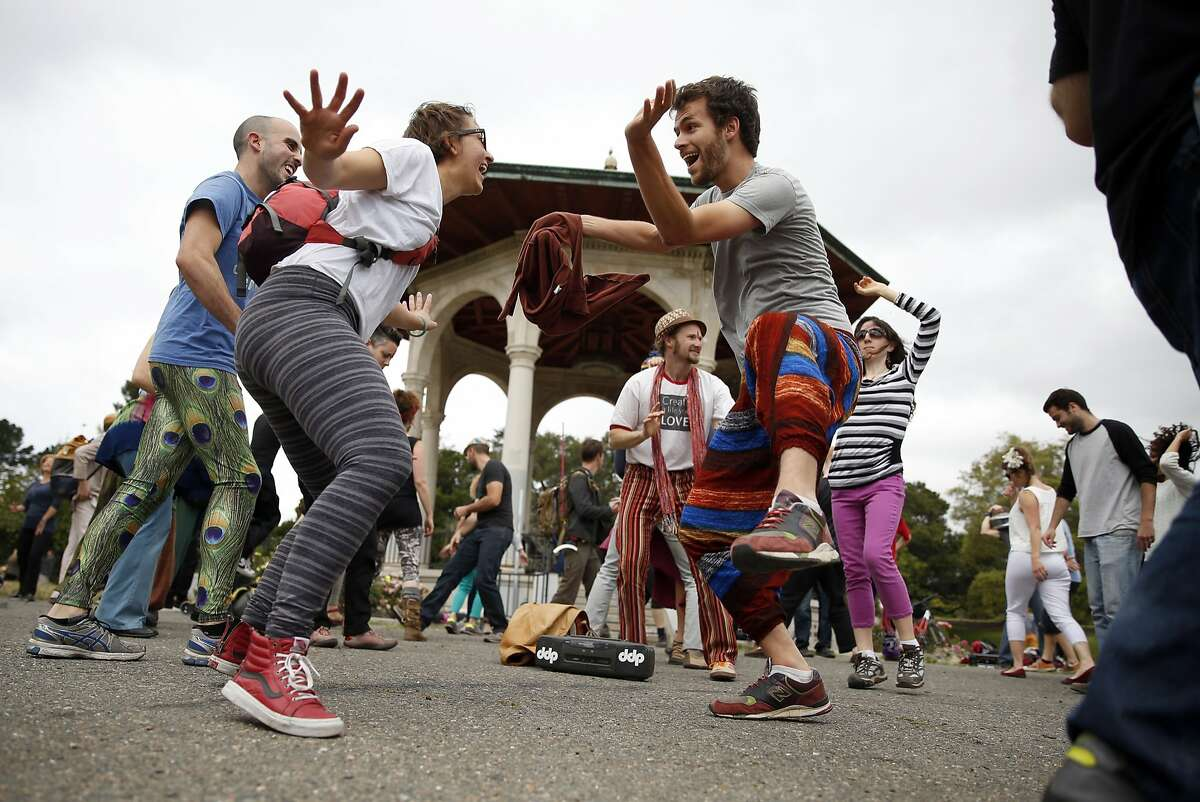 Jeremy Blanchard (right) and Jess Serrante, both of Oakland, dance by the gazebo as Ecstatic Dance puts on