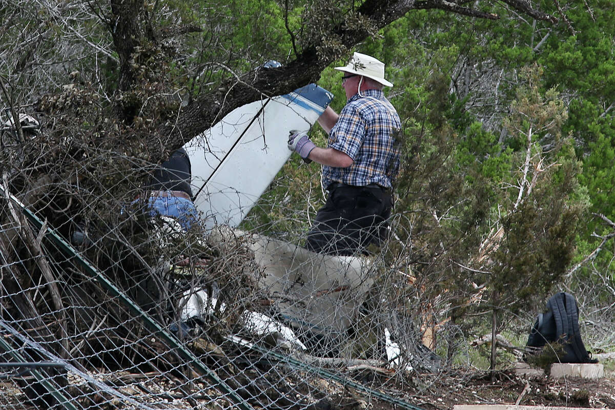 National Transportation Safety Board and Federal Aviation Administration investigators look for clues at the scene of a plane crash in Spring Branch, Sunday, May 17, 2015. Emergency personnel responded to the scene on Saturday and found that Michael Scott Galloway, 38, his wife, Louise Galloway, 32, and their two children, Clayton, 10 and Cheyenne Elizabeth, 8, died in the fiery crash. The single-engine Piper PA-24 had just departed Kestrel Air Park near the crash site.