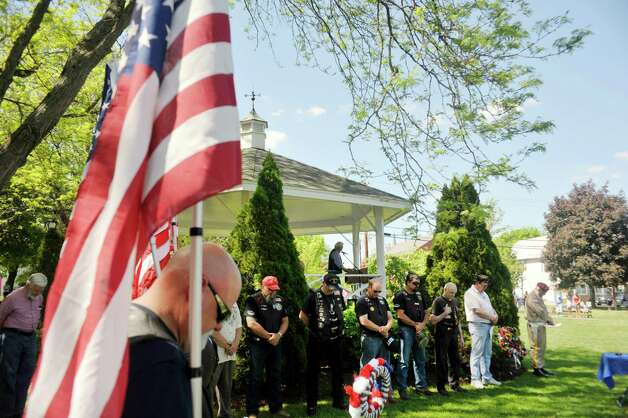 Veterans bow their heads for the opening prayer during  the Altamont Memorial Day Parade on Sunday, May 17, 2015, in Altamont, N.Y.    (Paul Buckowski / Times Union) Photo: PAUL BUCKOWSKI / 00031853A
