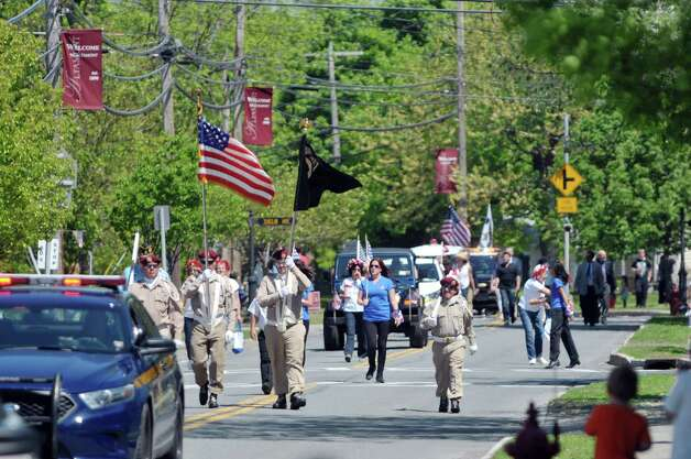 People watch from the sides of Main St. as participants march in the Altamont Memorial Day Parade on Sunday, May 17, 2015, in Altamont, N.Y.    (Paul Buckowski / Times Union) Photo: PAUL BUCKOWSKI / 00031853A