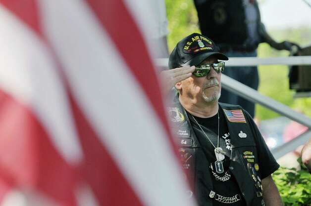 Air Force veteran Ed Czuchrey from Guilderland Center salutes during the Altamont Memorial Day Parade on Sunday, May 17, 2015, in Altamont, N.Y.    (Paul Buckowski / Times Union) Photo: PAUL BUCKOWSKI / 00031853A