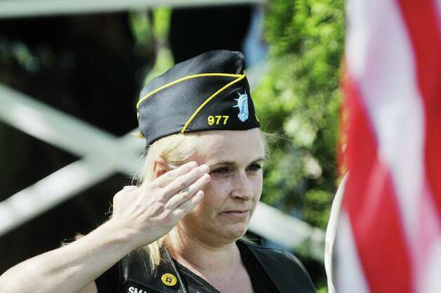 Army veteran and Legion Post 977 member Patti Ruiz from Berne salutes during the playing of Taps at the Altamont Memorial Day Parade on Sunday, May 17, 2015, in Altamont, N.Y.    (Paul Buckowski / Times Union) Photo: PAUL BUCKOWSKI / 00031853A