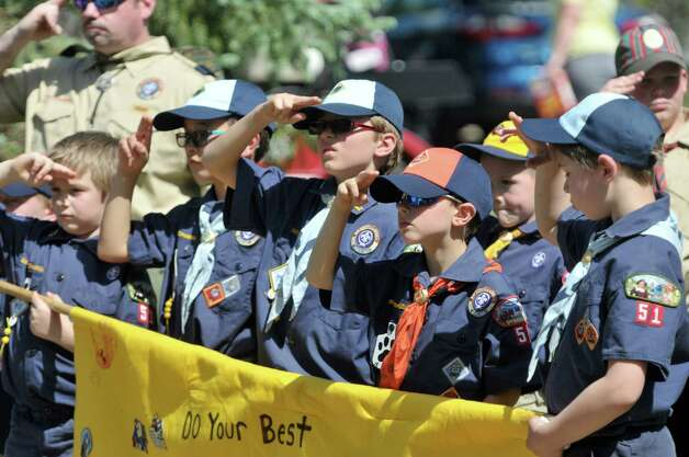 Members of the Altamont Cub Scouts Pack 51 salute as a memorial wreath is placed during the Altamont Memorial Day Parade on Sunday, May 17, 2015, in Altamont, N.Y.    (Paul Buckowski / Times Union) Photo: PAUL BUCKOWSKI / 00031853A