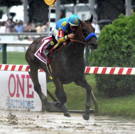American Pharaoh with jockey Victor Espinoza flies across a very muddy track to win the 140th running of the Preakness Stakes held at Pimlico Race Course Saturday evening May 16, 2015 in Baltimore, MD  (Skip Dickstein/Times Union) Photo: SKIP DICKSTEIN
