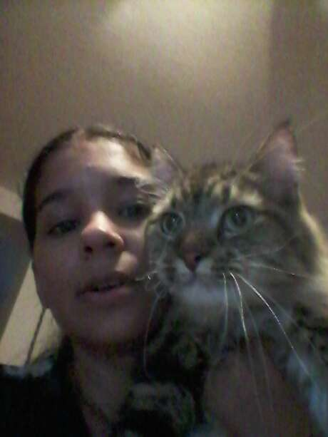 Danika Tolbert with her cat, Cortez. On May 5, her cat went missing and ended up at Animal Care Services, where she said it was misidentified and its microchip was undetected. Photo: Courtesy Photo / Courtesy Photo