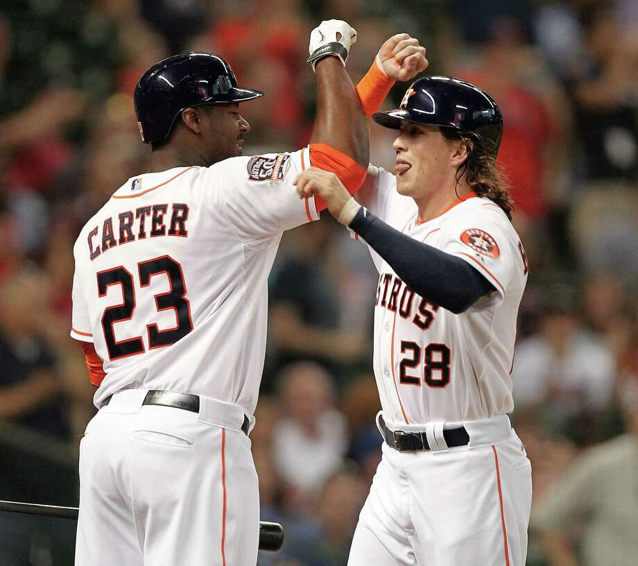 Outfielder Colby Rasmus, left, had reason to celebrate Sunday after hitting a go-ahead solo homer in the sixth inning to help the Astros beat the Blue Jays, the team he played with the previous four seasons. Photo: Bob Levey, Stringer / 2015 Getty Images
