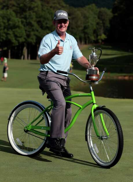 Jeff Maggert poses with the trophy and a new bike after winning the Regions Tradition tournament Sunday. It was Maggert's first Champions Tour major victory. Photo: Butch Dill, FRE / FR111446 AP