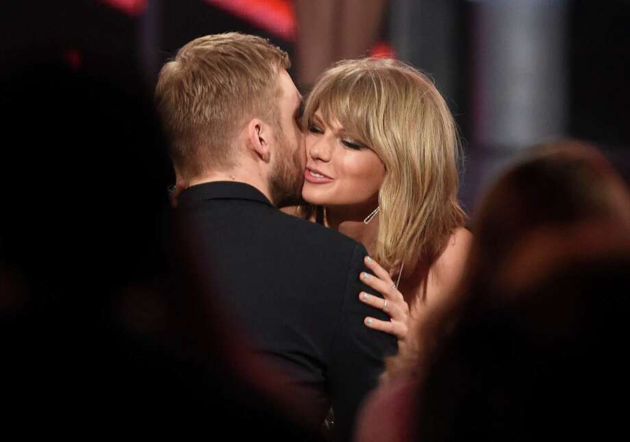 """Taylor Swift, right, hugs Calvin Harris after winning the award for top billboard 200 album for """"1989"""" at the Billboard Music Awards at the MGM Grand Garden Arena on Sunday, May 17, 2015, in Las Vegas. (Photo by Chris Pizzello/Invision/AP) Photo: Chris Pizzello, INVL / Invision"""