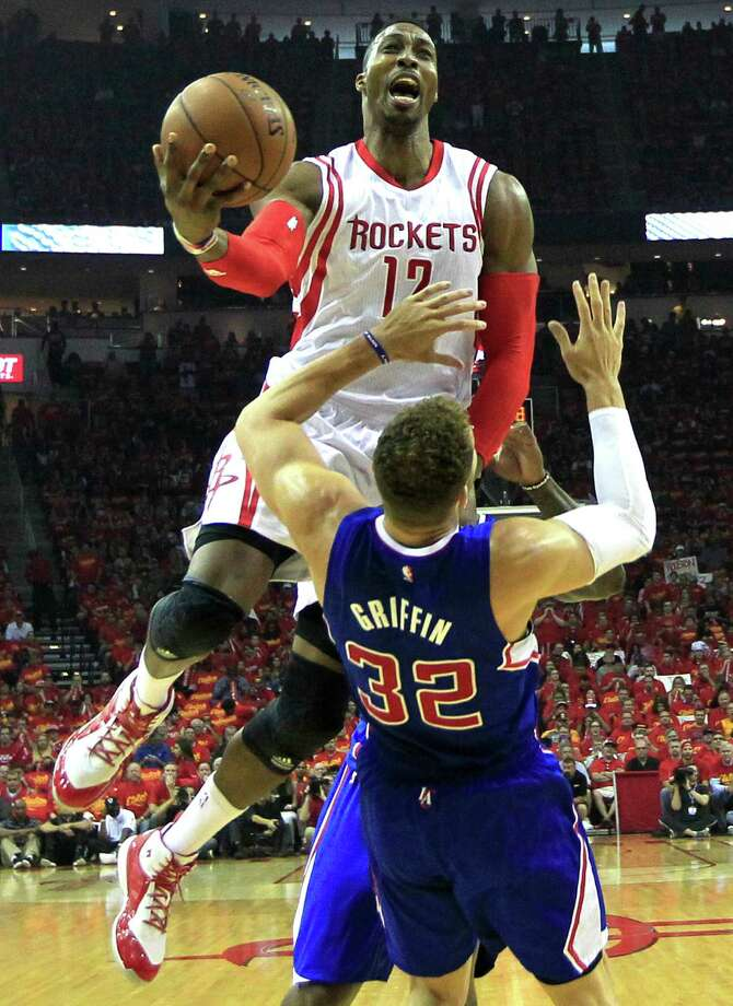 Dwight Howard (12) raised his game with his sixth double-double (16 points, 15 rebounds) of the series, and Blake Griffin and the Clippers could do little about it. Photo: James Nielsen, Staff / © 2015  Houston Chronicle