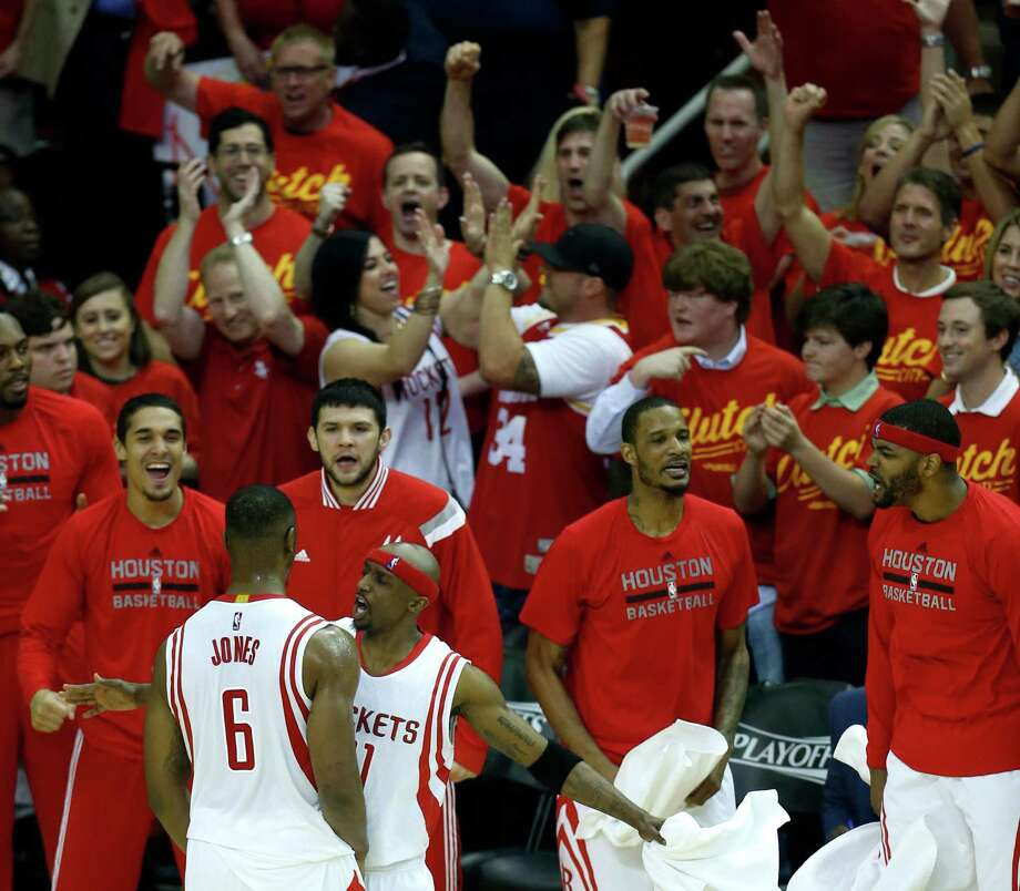 Rockets forward Terrence Jones (6) is greeted at the bench by guard Jason Terry (31) after Jones hit a shot against the Clippers in the first quarter. The fans in the good seats get in on the celebratory action as well. Photo: Karen Warren, Staff / © 2015 Houston Chronicle