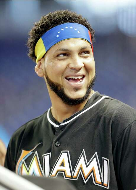 Miami Marlins pitcher Henderson Alvarez wears a Venezuelan headband before the start of a baseball game against the Oakland Athletics, Saturday, June 28, 2014 in Miami. (AP Photo/Wilfredo Lee) Photo: Wilfredo Lee, STF / AP