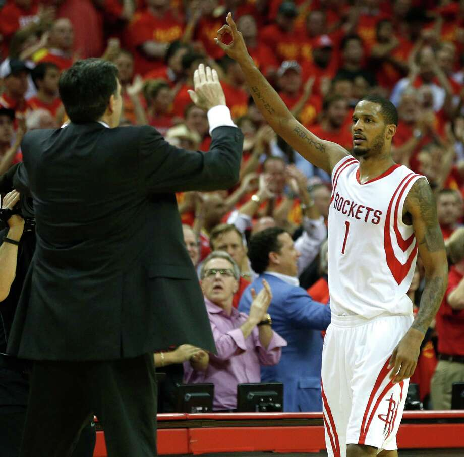 "Kevin McHale high-fives Rockets forward Trevor Ariza after his dramatic 3-pointer with 55 seconds left. Former Rockets forward Mario Elie later dubbed the shot ""Kiss of Death II."" Photo: James Nielsen, Staff / © 2015  Houston Chronicle"