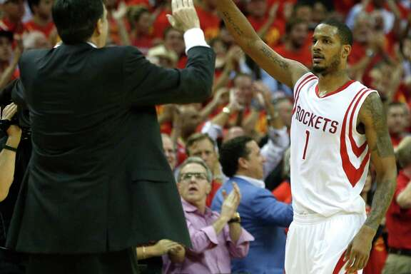 "Kevin McHale high-fives Rockets forward Trevor Ariza after his dramatic 3-pointer with 55 seconds left. Former Rockets forward Mario Elie later dubbed the shot ""Kiss of Death II."""