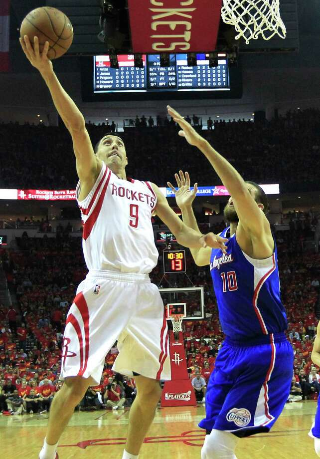 Houston Rockets guard Pablo Prigioni (9) takes the ball in for a layup against Los Angeles Clippers forward Spencer Hawes (10) during the first half of Game 7 of the NBA Western Conference semifinals at the Toyota Center Sunday, May 17, 2015, in Houston.  ( James Nielsen / Houston Chronicle ) Photo: James Nielsen, Staff / © 2015  Houston Chronicle