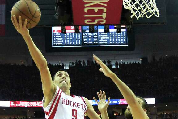 Houston Rockets guard Pablo Prigioni (9) takes the ball in for a layup against Los Angeles Clippers forward Spencer Hawes (10) during the first half of Game 7 of the NBA Western Conference semifinals at the Toyota Center Sunday, May 17, 2015, in Houston.  ( James Nielsen / Houston Chronicle )