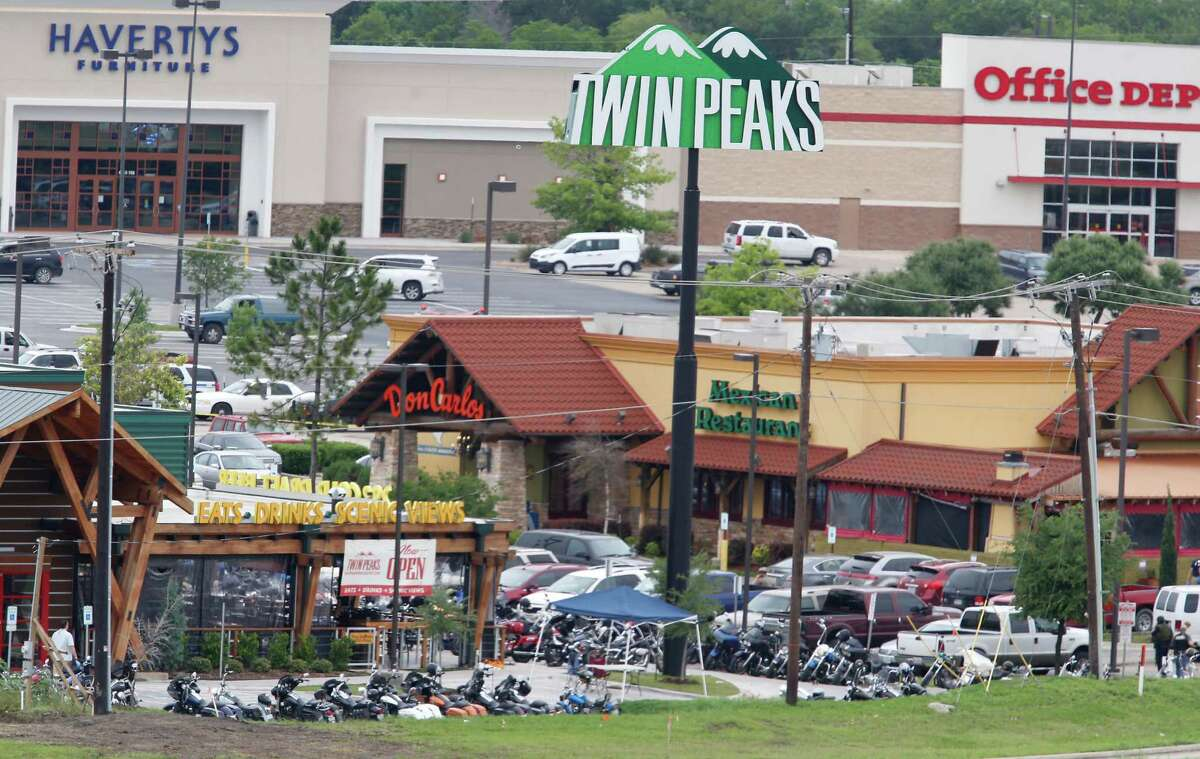 Law enforcement officers investigate the parking lot of a Twin Peaks restaurant Sunday, May 17, 2015, in Waco, Texas. Waco Police Sgt. W. Patrick Swanton told KWTX-TV there were