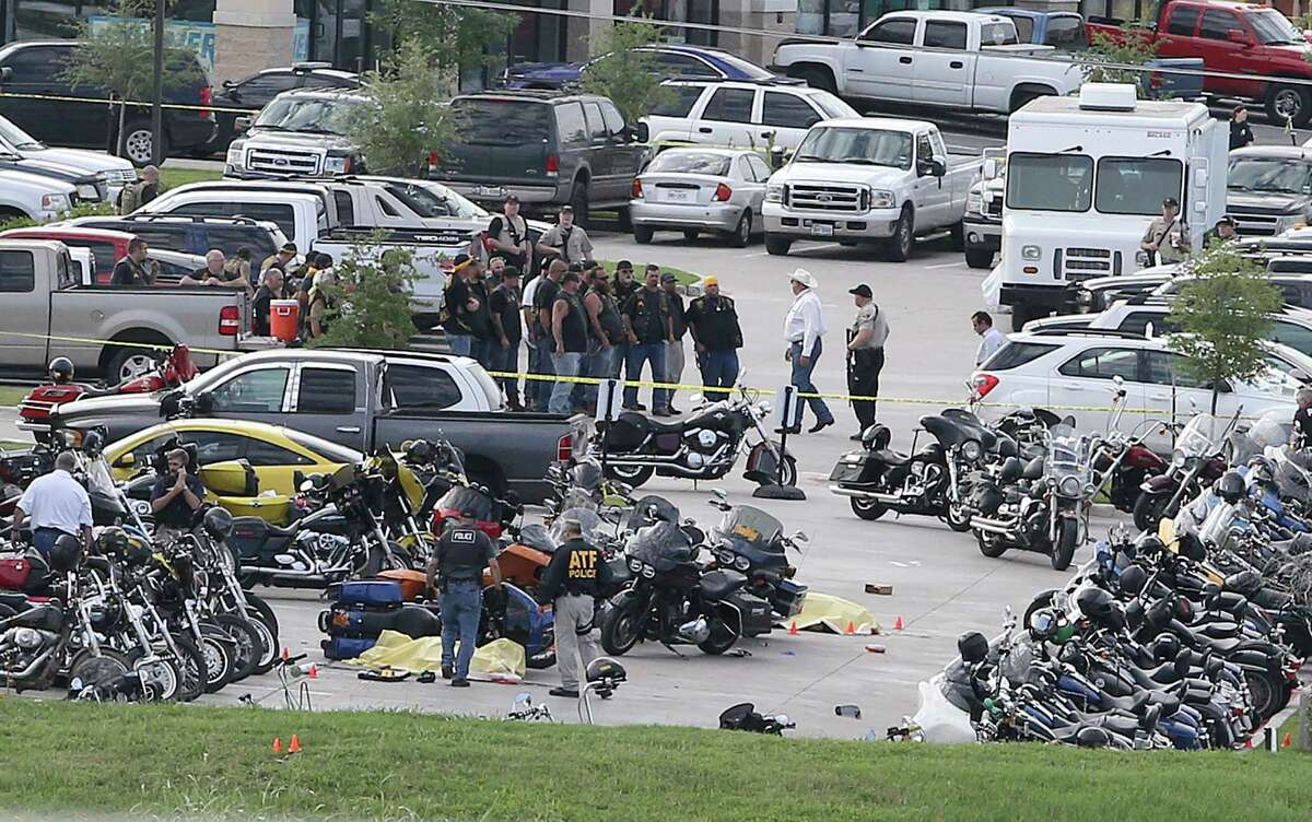 Authorities investigate a shooting in the parking lot of the Twin Peaks restaurant Sunday, May 17, 2015, in Waco, Texas. Authorities say that the shootout victims were members of rival biker gangs that had gathered for a meeting.