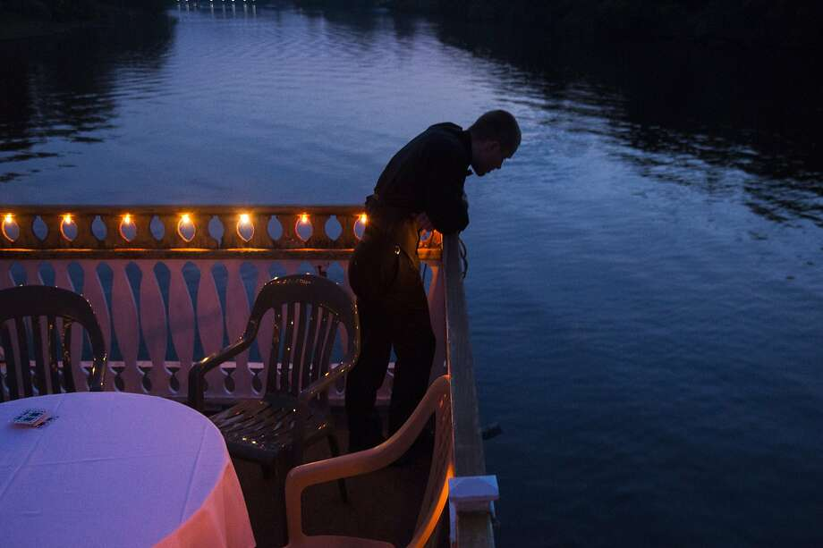 A student enjoy the view from the deck during Lake Fenton High School's prom aboard the Michigan Princess boat on Grand River on Saturday, May 16, 2015, in Lansing, Mich. (Zack Wittman/The Flint Journal-MLive.com via AP) LOCAL TELEVISION OUT; LOCAL INTERNET OUT Photo: Zack Wittman, Associated Press