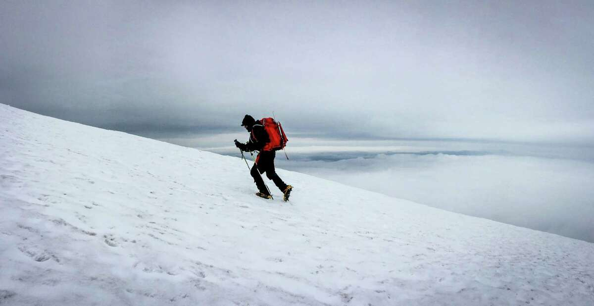 Climber Michael Naiman makes his way up a glacier during a climb to the rim of Mount St. Helens on Monday, May 11, 2015. The volcano in southwest Washington exploded 35 years ago, on May 18, 1980.