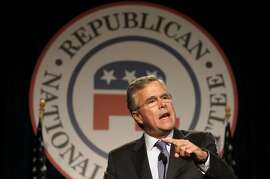 FILE - In this May 14, 2015 file photo, former Florida Gov. Jeb Bush speaks at the Republican National Committee spring meeting in Scottsdale, Ariz. For more than four hours, Bush worked his way through the dimly lit hallway of an Arizona resort, shuttling from one room to the next, meeting with dozens of Republican officials, many for the first time. After days of offering confusing answers to questions about the war in Iraq, disappointing Republicans in the leadoff state of Iowa and momentarily forgetting that he's not yet a candidate, he was in need of a political reset.  (AP Photo/Ross D. Franklin, File)