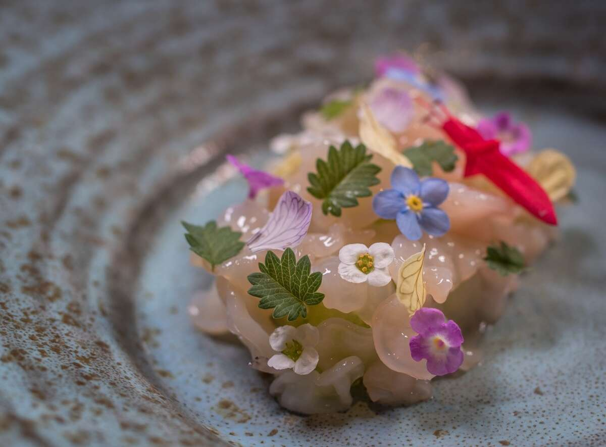 Geoduck with cucumber, salad burnet and spring flowers.