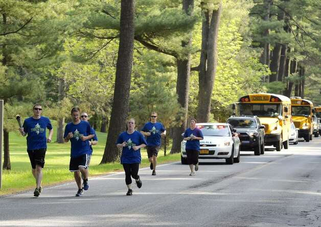 Members of Saratoga Springs Police Department and the State Park police kickoff the Torch Run for Special Olympics in Saratoga Springs on Monday. (Skip Dickstein
