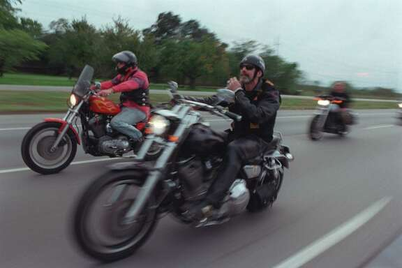 "CONTACT FILED:  BANDIDOS (MOTORCYCLE CLUB) METRO MONDAY: Jan 'The Man' Christensen, VP of the NW Houston Chapter, Bandidos Motorcycle Club, and others head home along I-10 west after a weekend party at Bryant's Ice House near Katy. The Bandidos Motorcycle Club made local news when four members were arrested on felony drug charges. after undercover officers from the  Harris County Organized Crime and Narcotics Task Force infiltrated the group. The group was formed in Houston in 1966 and has since grown to include chapters nation wide and in foreign countries, but  While police have said the group exsists to commit crime and sell drugs. members dispute that claim, saying they are simply bonded by brotherhood and a love of motorcycles.  (Smiley N. Pool/Chronicle) 11/05/00.      HOUCHRON CAPTION (01/16/2001):  Jan ""The Man"" Christensen, vice president of the Northwest Houston chapter, Bandidos Motorcycle Club, and others ride along Interstate 10 after a weekend party at Bryant's Ice House near Katy. The group, formed in Galveston County in 1966, now has chapters worldwide."
