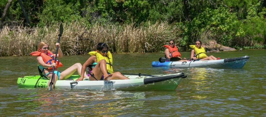Kayakers explore the waters of Inks Lake State Park in Burnet, Texas, on April 25, 2015. The park is a popular spot for kayakers and canoers. Photo: Joshua Trudell /For The Express-News