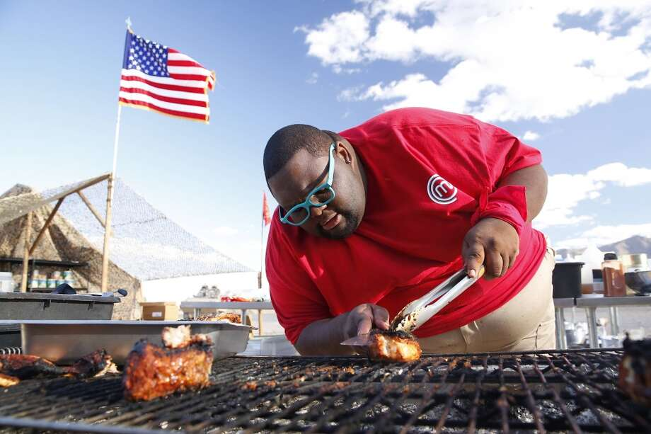 "Houston's Willie Mike mans the grill during a Season 5 episode of Fox's ""MasterChef."" On the episode, the challengers had to fee an army of 500 servicemen and women on a desert army base. Photo: Greg Gayne, Fox"