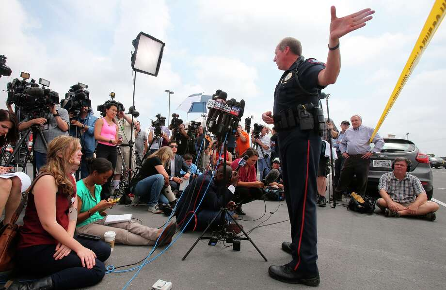 Waco Police Sgt. Patrick Swanton updates reporters on the status of the investigation into the shooting that killed nine people. Photo: Jerry Larson / Associated Press / FR91203 AP