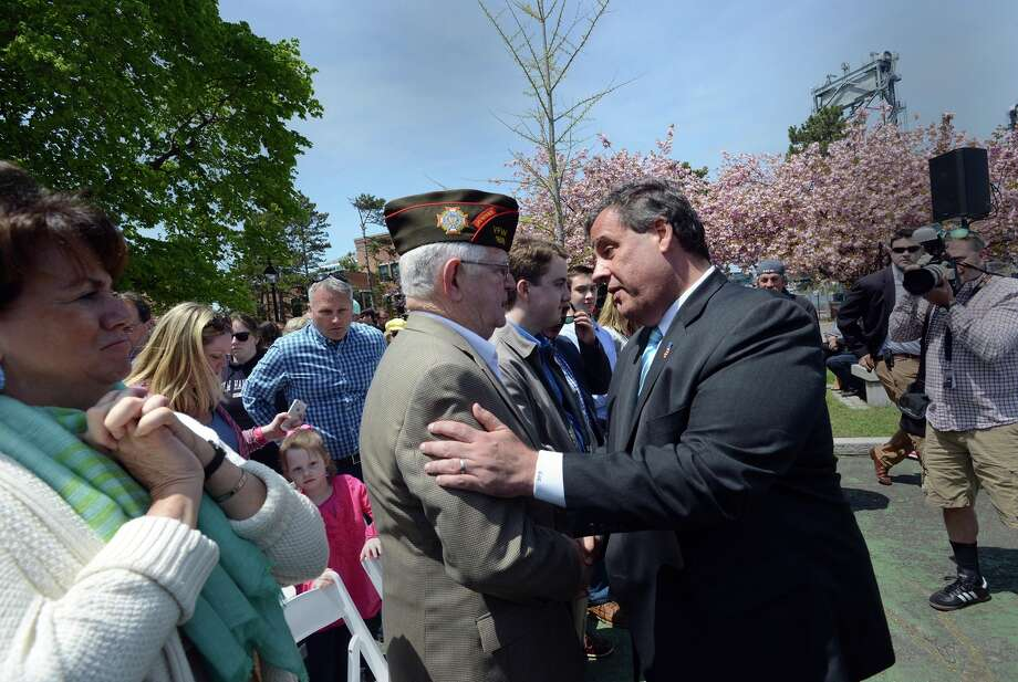 New Jersey Gov. Chris Christie (right) shakes hands with veteran Paul Chevalier after giving a speech on foreign policy in the early-voting state of New Hampshire. Photo: Darren McCollester / Getty Images / 2015 Getty Images