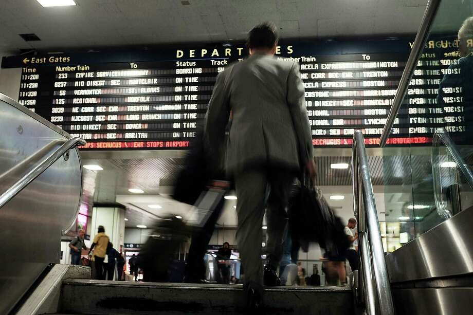 NEW YORK, NY - MAY 18: A man walks up the stairs in front of the departure board as normal service returned between New York City and Philadelphia on May 18, 2015 in New York City. Service in the busy Northeast Corridor was disrupted following a a deadly crash in Philadelphia last week that is still being investigated. last Tuesday evenings crash killed eight people and injured more than 200 others. Photo: Spencer Platt / Getty Images / 2015 Getty Images