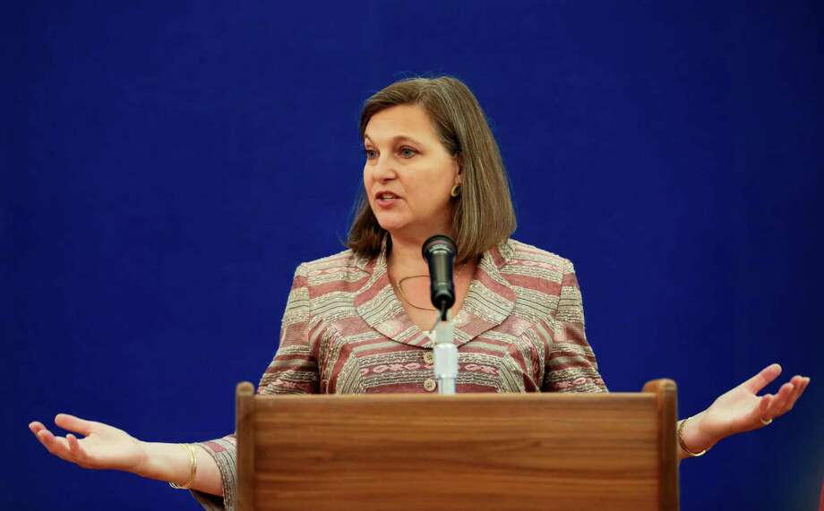 "Assistant Secretary of State Victoria Nuland gestures during a press conference at the Spasso House — residence of the U.S. ambassador to Russia in Moscow. Two Russian soldiers captured while fighting in war-torn eastern Ukraine are receiving treatment in a hospital to the capital, Kiev, Ukrainian officials said. Nuland said she welcomed the Ukrainian government's assurances that the soldiers ""are being well taken care of"" and that the representatives of the International Committee of the Red Cross would be allowed to visit them. Photo: Ivan Sekretarev / Associated Press / AP"