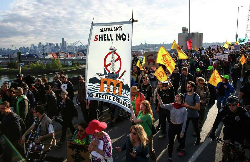 Marchers make their way over the Spokane Street bridge during a protest against Arctic oil drilling and the mooring of Shell Oil's Polar Pioneer drilling rig in Seattle. Protesters blocked entrances to the port during the protest. Photographed on Monday May 18, 2015.