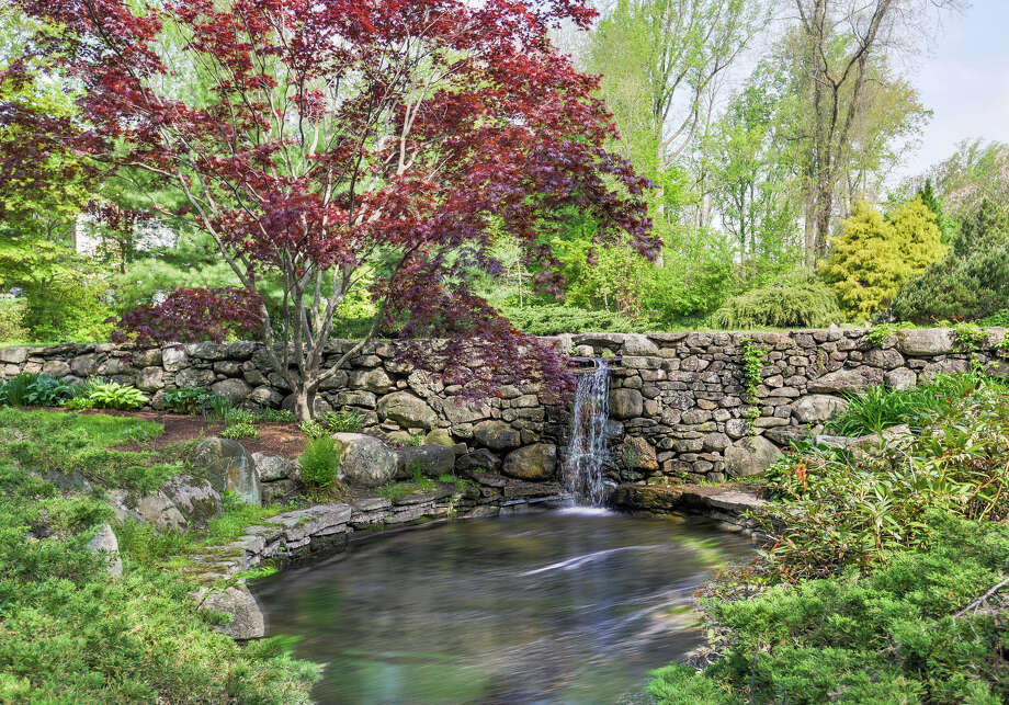 The landscaped grounds and gardens at 8 Peabody Lane in Westport have water features and lush plantings. Photo: Contributed Photo / Westport News