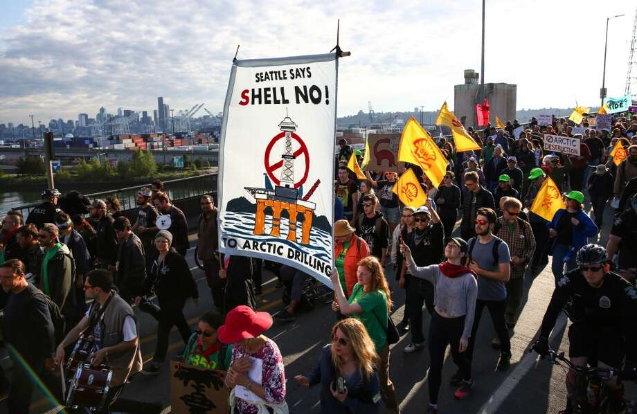 Marchers make their way over the Spokane Street bridge during a protest against Arctic oil drilling and the mooring of Shell Oil's Polar Pioneer drilling rig in Seattle. Protesters blocked entrances to the port during the protest. Photographed on Monday May 18, 2015. (Joshua Trujillo, seattlepi.com) Photo: JOSHUA TRUJILLO, SEATTLEPI.COM
