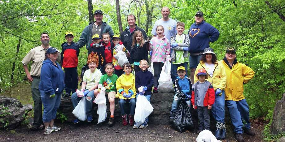 Members of New Milford Cub Scout Pack 467, along with family members and friends, take a break Saturday, May 16 from their cleanup project to pose for a photo at Lover's Leap State Park in New Milford.  Courtesy of Holly Sartori Photo: Contributed Photo / The News-Times Contributed