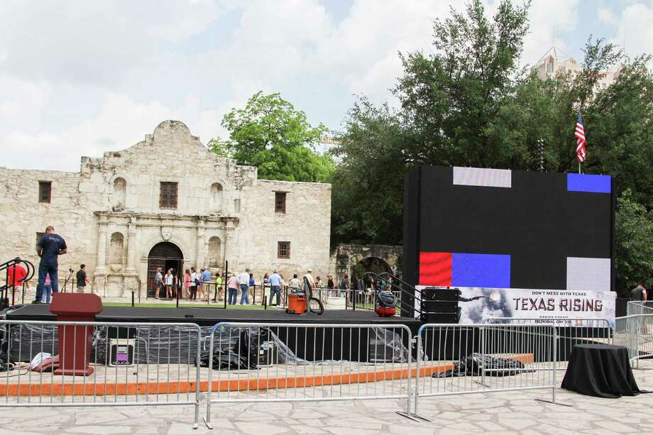 "Crew members work to setup a red carpet gala into the Alamo Monday for a special preview of the upcoming ""Texas Rising"" miniseries. Photo: Photo By Tyler White/SAEN"