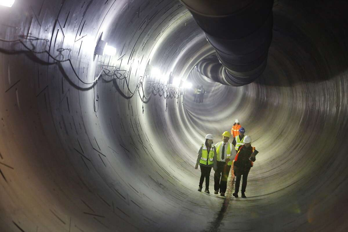 People on a tour walk through the northbound tunnel of the Central Subway on Monday, May 18, 2015 in San Francisco, Calif.