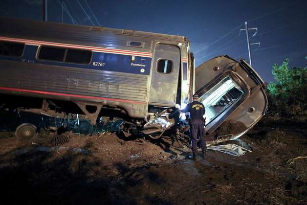 In this May 12, 2015 file photo, emergency personnel work the scene of a deadly train wreck in Philadelphia. Five years ago, federal safety officials proposed requiring video cameras in train cabs, but it didn't happen. That's left a gap as investigators try to unravel last week's fatal Amtrak derailment. Photo: Joseph Kaczmarek, AP Photo/ Joseph Kaczmarek/file / Associated Press