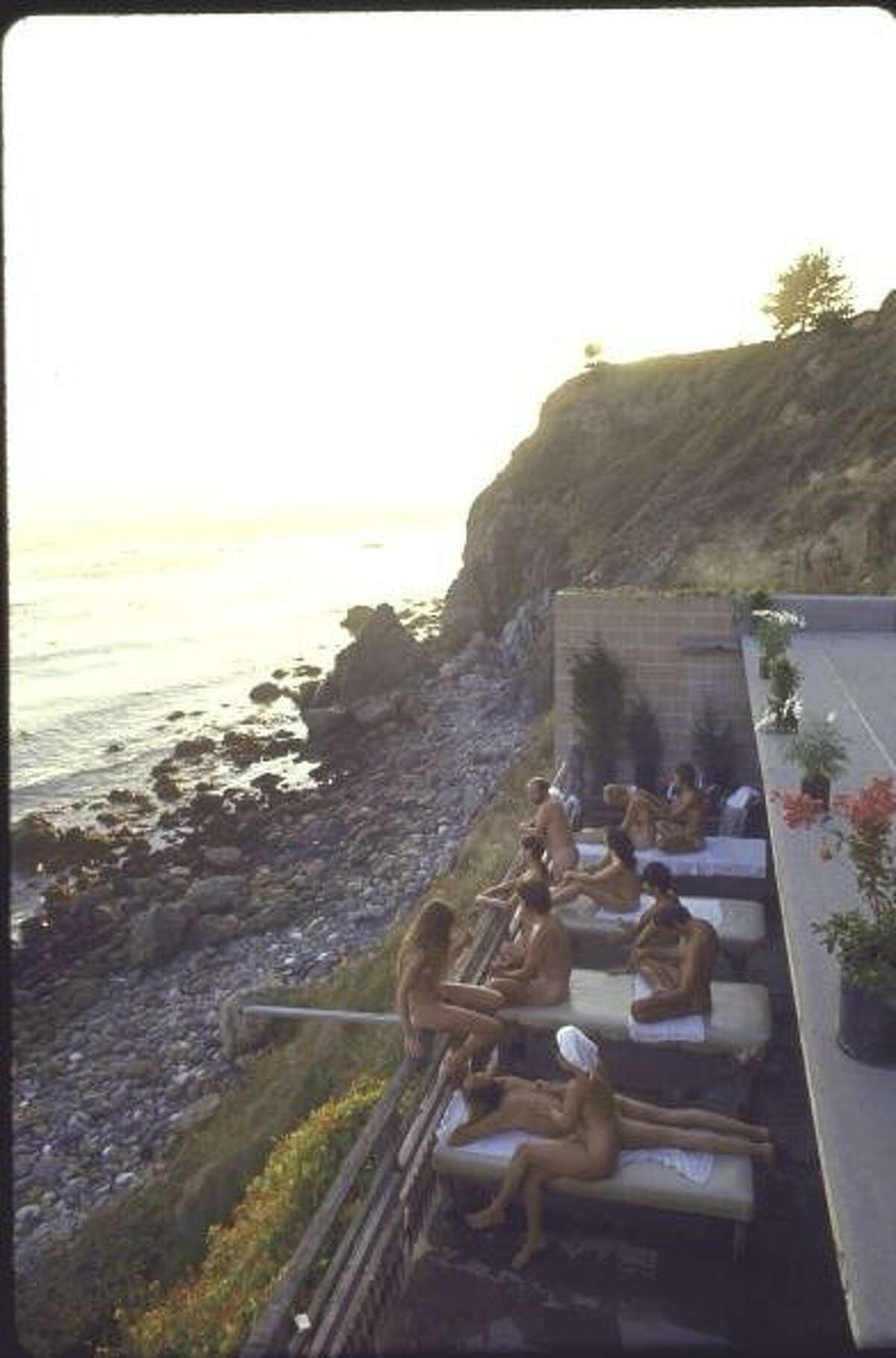 Nude couples on a balcony Jan. 1, 1970, at the Esalen Institute in Big Sur, Calif., a place for yoga, meditation, bongo drums and other staples of the hippie philosophy.