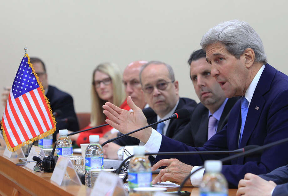 Secretary of State John Kerry (right) urges North Korea to dismantle its arsenal of nuclear weapons. Photo: CHUNG SUNG-JUN / New York Times / POOL
