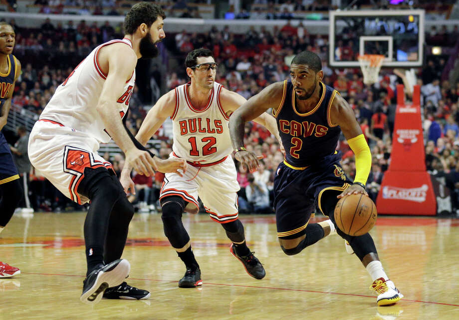 Cavaliers guard Kyrie Irving, shown playing hurt against the Bulls last week, has had right foot and left knee problems during the postseason. Photo: Nam Y. Huh / Associated Press / AP
