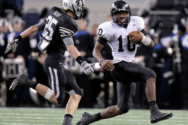 Steele's Tommy Armstrong looks for room around Denton Guyer's Zach Bush during first half action of the Class 5A Division II state final on Dec. 18, 2010 at Cowboys Stadium in Arlington.