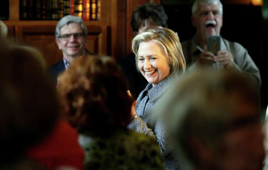 Democratic presidential candidate Hillary Rodham Clinton smiles as she is greeted before speaking at a gathering at the home of Dean Genth and Gary Swenson, Monday, May 18, 2015, in Mason City, Iowa. Photo: Charlie Neibergall / Associated Press / AP
