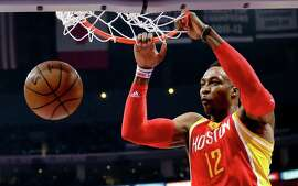 Houston Rockets center Dwight Howard dunks against the Los Angeles Clippers during the first half of Game 3 in a second-round NBA basketball playoff series Friday, May 8, 2015, in Los Angeles. (AP Photo/Jae C. Hong)