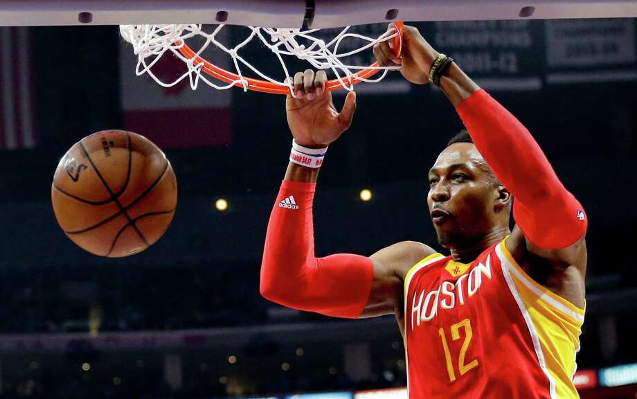 Houston Rockets center Dwight Howard dunks against the Los Angeles Clippers during the first half of Game 3 in a second-round NBA basketball playoff series Friday, May 8, 2015, in Los Angeles. (AP Photo/Jae C. Hong) Photo: Jae C. Hong / Associated Press / AP