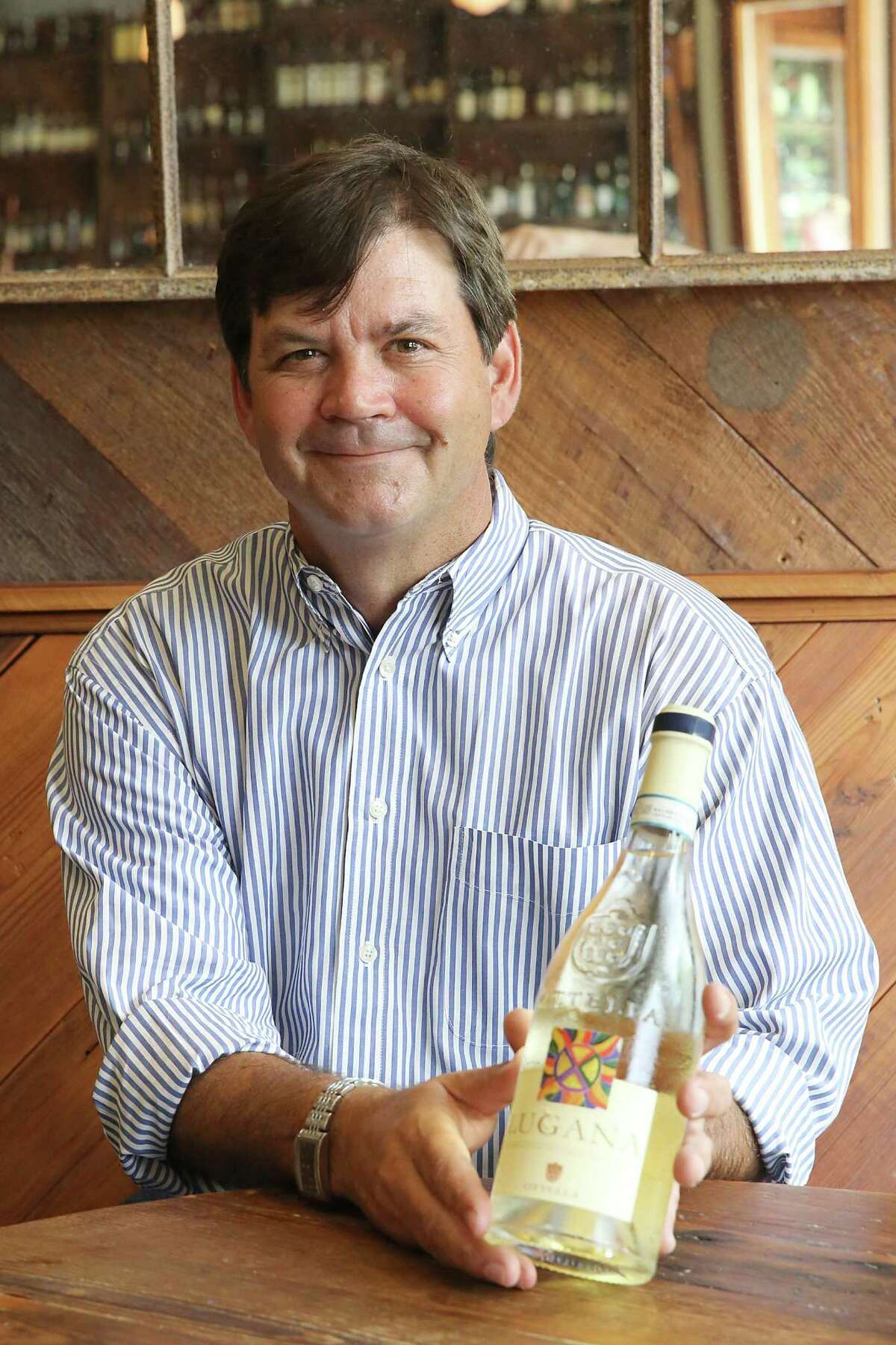 Jeb Stuart, General Manager and Wine Program Director at Coltivare with a 2013 bottle of Ottella Luguna on Thursday , May 14, 2015 in Houston, TX.. (Photo: Thomas B. Shea/For the Chronicle)