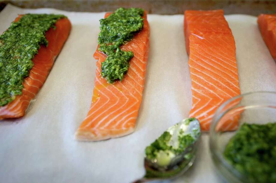 Slow-broiled salmon with an green herb, shallots, and oil rub in San Francisco, Calif., on Wednesday, May 6, 2015. Photo: Amy Osborne, INTERN / ONLINE_YES